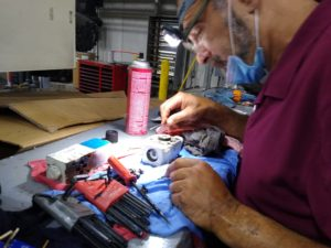 Field service technician John Blagojevic disassembling, cleaning and inspecting a inkection manifold hydraulic valve